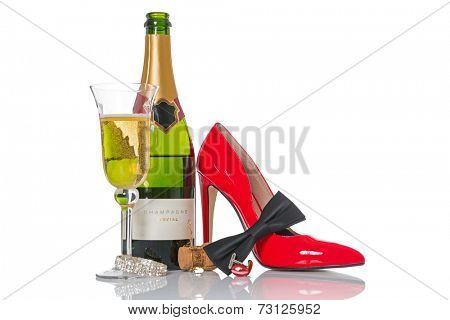 Champagne and black tie with red shoes and accessories isolated on a white background.