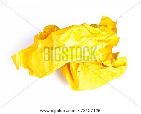Screwed up piece of yellow paper isolated on white background