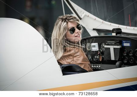 Female pilot inside airplane cockpit