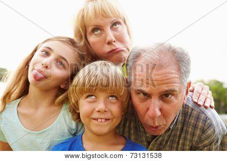 Grandparents And Grandchildren Pulling Funny Faces