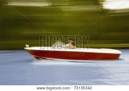 Blurred motion shot of motorboat
