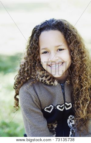 Young African girl with braces smiling