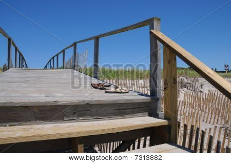 Wooden Boardwalk stairs and sandals