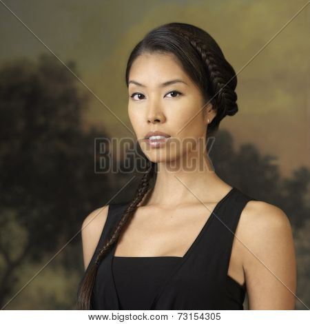 Portrait of Asian woman with braid in hair