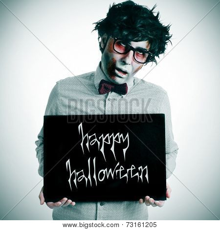a hipster zombie showing a black signboard with the text happy halloween written in it