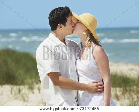 Multi-ethnic couple kissing