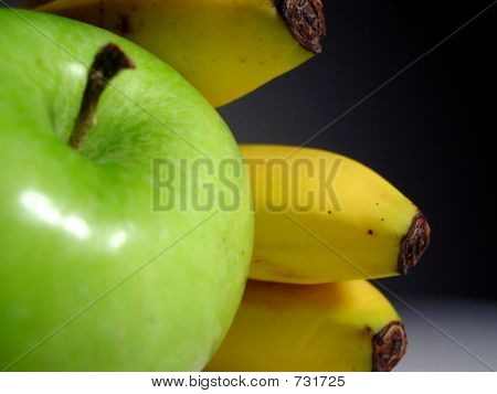 green apple with bananas
