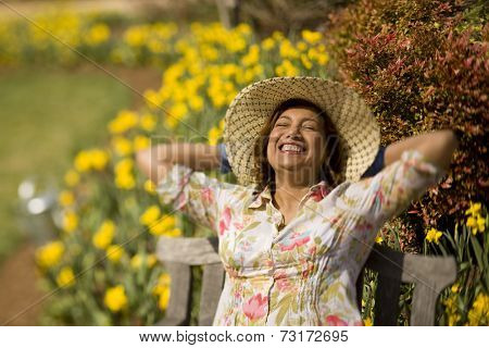 Hispanic woman wearing sun hat