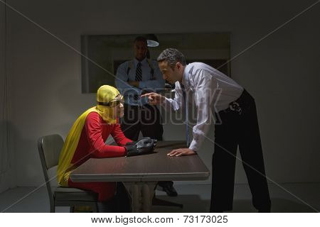 Super hero being interrogated by police