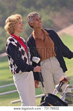 Multi-ethnic senior women on golf course