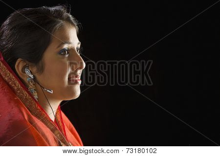 Indian woman wearing hands free device