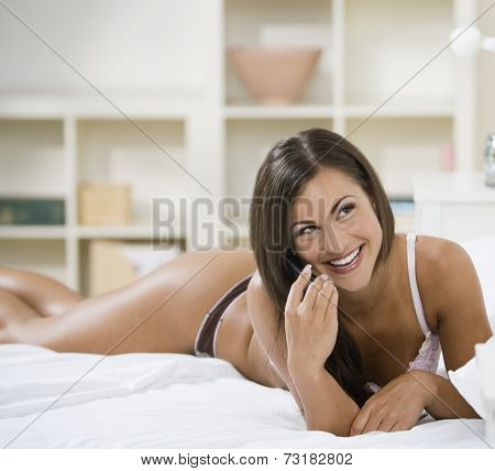 Woman in underwear talking on cell phone