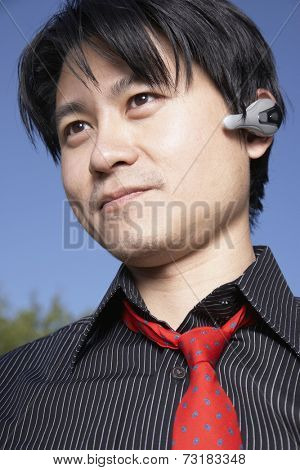 Asian man using hands free device