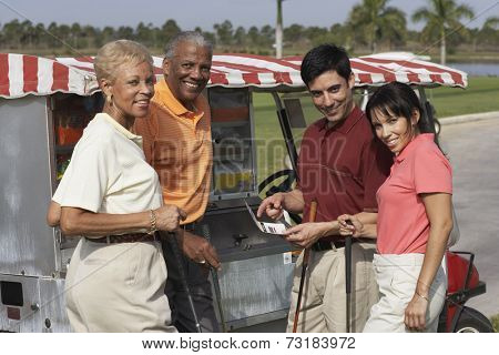Multi-ethnic couples at food stand on golf course