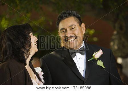 Hispanic couple in evening wear