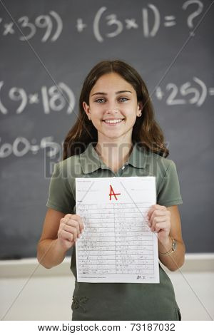 Girl holding up A paper