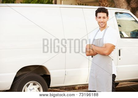 Man Wearing Apron Standing In Front Of Van