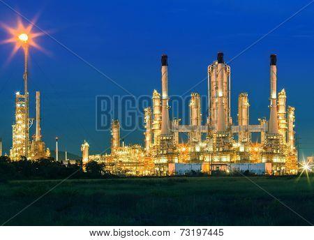 Lighting Of Oil Refinery Palnt Against Dusky Blue Sky Of Oil Refinery Plant In Heavy Petrochemical I