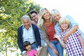 Happy 3 generation family in grandparents' backyard poster