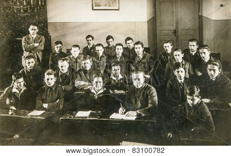 BERLIN, GERMANY, CIRCA 1930's: Vintage photo of schoolboys with their teacher in class