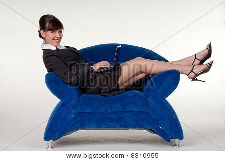 Secretary lying  in blue coach