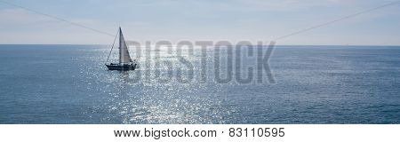 A sailing boat, yacht on a beautiful sunny day