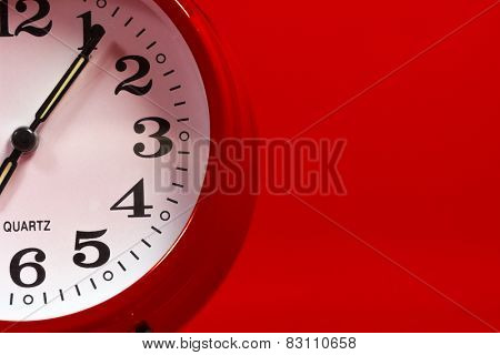 Red alarm clock on a red background with copy space
