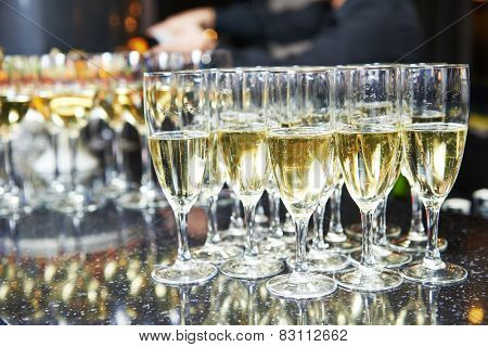 catering services. glasses with wine in row background at restaurant party