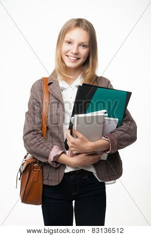 Portrait of a cheerful attractive young student woman.