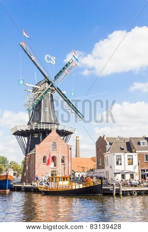 Typical windmill and medieval architecture in Haarlem, Netherlands