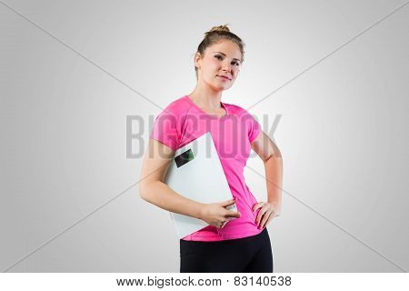 Confindent woman with weight scale