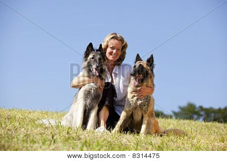 smiling woman with her dogs