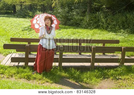 Woman With Umbrella Near Bridge
