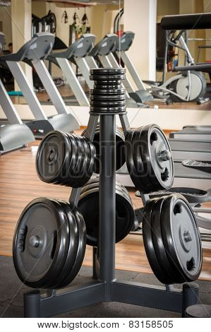 Barbell plates rack in the gym