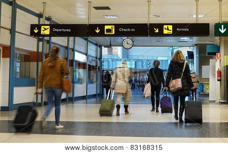Women Airline Passengers in an Airport