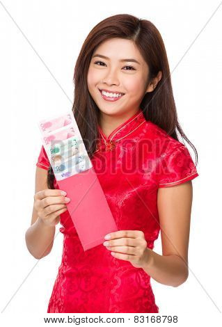 Asian woman hold red pocket with RMB for chinese new year
