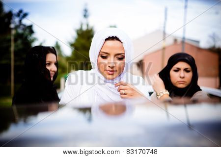Beautiful young muslim woman. Muslim bride before wedding, wearing white hijab in front of mosque