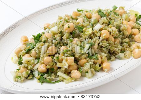 Freekeh salad with chickpeas, onion, parsley, celery, and a lemon juice and olive oil dressing poster