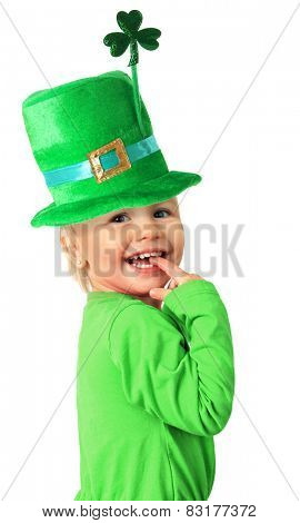 Happy smiling two year old girl wearing a St Patrick's day hat with Shamrock.