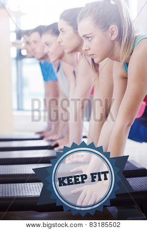 The word keep fit and instructor with fitness class performing step aerobics exercise against badge