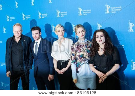 BERLIN, GERMANY - FEBRUARY 13: Director Kenneth Branagh with film team, 'Cinderella' photocall.65th Berlinale International Film Festival at Grand Hyatt Hotel on February 13, 2015 in Berlin, Germany
