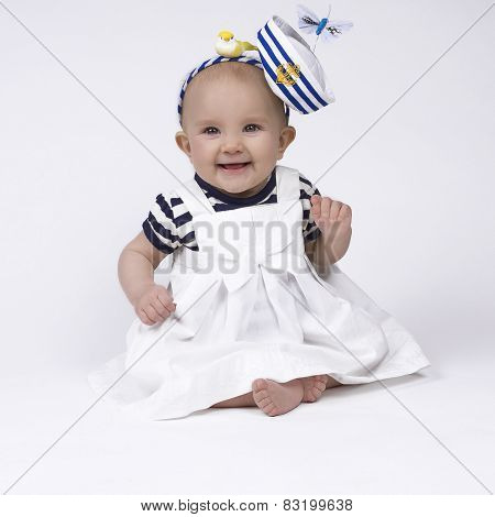 cute baby girl in sailor outfit