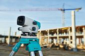Surveyor equipment optical level outdoors at construction site poster