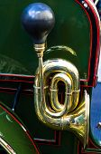 horn - chrome-plated trumpet part of an old car poster