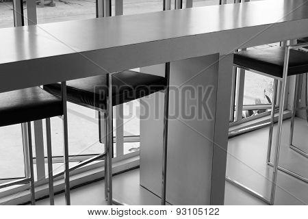 Black Leather Bar Stool Beside The Window