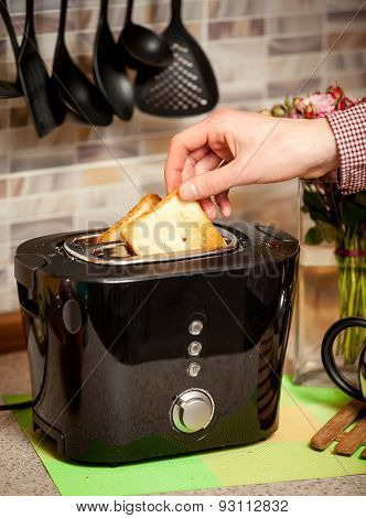 Closeup Of Man Putting White Bead Slices In Toaster