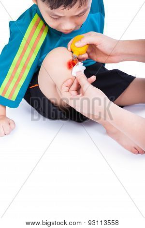 Little Asian (thai) Boy Looking Wound His Leg