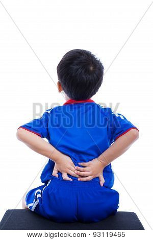 Back Pain. Child Rubbing The Muscles Of His Lower Back