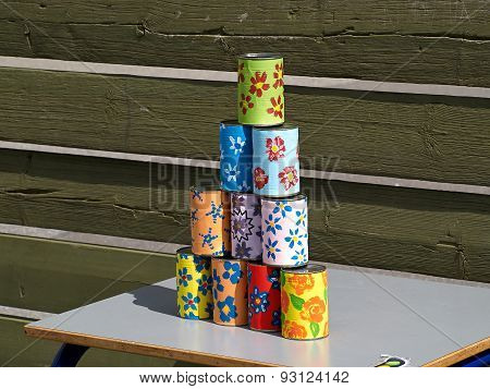 Pyramid Of Tin Cans For Throwing Balls At Them