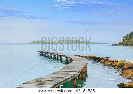 Beautiful seascape in morning time with wood bridge into sea poster